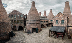 Gladstone Pottery (Andrew Stawarz) Tags: china industry museum clouds courtyard stokeontrent pottery fujifilm cart coal staffordshire porcelain adobelightroom saggers hdrpanorama xt10 gladstonepottery biscuitkiln fujinonxf1024mmf4rois 15image bottleovenkilns glostkiln