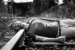 happy cadaver (SBW-Fotografie) Tags: blackandwhite bw man monochrome hat person suicide sigma railway hut mann monochrom schwarzweiss schienen sbw schwarzweis sigmaex freitod sbwfoto sbwfotografie