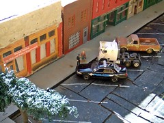Christmas Eve 2016 (THE RANGE PRODUCTIONS) Tags: fordcrownvictoriapoliceinterceptor freightliner cabover truck toy pickup chevy chevrolet greenlight 164scale 187 187scale hoscalefigures dioramas diecastdioramas diecast promotex hoscale building