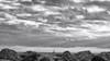 faire signe au bateau (glookoom) Tags: bw blackandwhite noiretblanc monochrome contraste lumière light paysage landscape plage mer nuage cloud soleil sun rocher bateau boat effet extérieur eau gris water sunscape palavas france