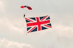 Parachutist - Brandshatch (photowarrington) Tags: red parachute aerial bttc brandshatch motorsport touringcar display unionjack flag falling proud