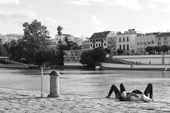 relax (micky_maz) Tags: relax river siviglia monochrome lovers boyandgirl perfectmoment sweetmoment tenderness sweetyguys blancoynegro lyingdown stealedshot