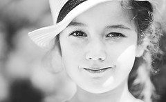 Straw hat (Wojtek Piatek) Tags: ireland summer portrait dublin reflection girl smile hat mono eyes pretty child straw 135 portret strawhat zeiss135 sonya99