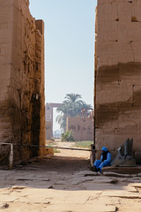 A guard at Karnak temple, Luxor (Egypt, 2014) (Steffen Kamprath) Tags: architecture city decayed desert documentary light luxor religion sight streetphotography temple travel gypten sonya77 availablelight history ruin tamronspaf1750mmf28xrdiii slt dslr apsc cityscape urbangeometry backlight amount zoomlens skyline urban urbanlife urbanlandscape bygonetimes olddays ancient lostcivilization hulk attraction spot landmark tourism traveldestination travelphotography traveling vacation africa afrika afrique frica egypt egipto egypte egito