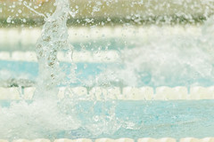 Swim Splash in Pool (Erin Cadigan Photography) Tags: abstract blue blur competition competitive droplet horizontal indoors inside lane line marker meet motion movement moving pool race rope splash sport swim swimmer swimming team water