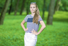 Teenagers Lifestyle Concepts. Portrait of Blond Caucasian Teenager Posing in Green Forest. (DmitryMorgan) Tags: 1 1319years attractive beautiful blond blondyhair casual caucasian cheerful concept cute day enjoying female forest happy holidays joyful leisure leisureactivity lifestyle lifetime lovely one outdoors park positive relaxing skirt smiling standing stripe stripy stylish summer sunglasses sunny teen teenager vacation white younggirl youth