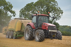 Case IH Magnum 335 Tractor with a Krone Big Pack 1290 High Speed Baler (Shane Casey CK25) Tags: case ih magnum 335 tractor krone big pack 1290 high speed baler cnh red castlelyons casenewholland grain harvest grain2016 grain16 harvest2016 harvest16 corn2016 corn crop tillage crops cereal cereals golden straw dust chaff county cork ireland irish farm farmer farming agri agriculture contractor field ground soil earth work working horse power horsepower hp pull pulling cut cutting knife blade blades machine machinery collect collecting nikon d7100 tracteur traktor traktori trekker trator ciągnik