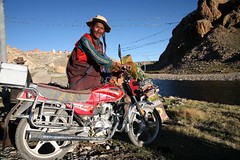 Tibetan Buddhist Pilgrim and Motor Bike Tirthapuri Sacred Site Far Western Tibet (eriagn) Tags: roofoftheworld asia china tibet tirthapuri tibetan buddhist pilgrim mother kora sacred eriagn canon eos rugged child journey religion remote isolated beads hats warmth coat braiding hair travel documentary empty hardy survival harsh living belief photography social reportage silkroad costume textile amber silver coral turquoise jewellery traditional woman mountkailash mountkailas sutlejriver highaltitude tibetanplateau terrain pilgrimage local people