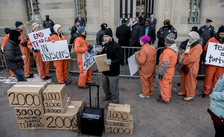 A Protester Addresses Onlookers During an Anti-Tear-Gas Demonstration Outside the U.S. Department of Justice