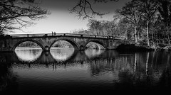 Clumber Park Bridge. (Ian Emerson) Tags: arches water lake nottinghamshire nationaltrust countryside countrypark park stone reflection trees blackwhite outdoor landscape people