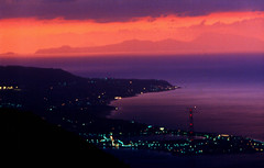 Sunset at the gates of Sicily (*Maurizio*) Tags: blue sunset red sea sky italy seascape colors topv111 night catchycolors skyscape lights italia mare shadows purple violet sicily calabria sicilia urbanlights