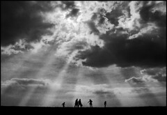 skies over brighton beach (adrians_art) Tags: light england sky people blackandwhite sun film beach monochrome tag3 taggedout clouds dark geotagged coast topf75 brighton tag2 tag1 500v20f silhouettes rays skyscapes themoulinrouge geotags 123bw lovephotography superaplus aplusphoto thegoldenmermaid