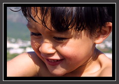 Bashful Me (Zulpha) Tags: ocean africa family boy shadow sea portrait sky sun mountain black color colour eye texture love beach 2004 wet water beautiful beauty smile face look tag3 taggedout kids youth digital swim laughing photoshop canon mouth hair children southafrica asian fun mouse outdoors nose happy grey one monkey us seaside kid spring cool eyes sand micky warm tag2 alone colours tag1 dof child play looking cheek skin sweet gorgeous teeth muslim small border young tan naturallight fringe shy capetown ps h2o chilling nephew dimple cheeks saturation ear laugh laughter express awake lovely left eastern flikr unforgettable pest edit campsbay canond30 splashing canoneosd30 admire 1on1halloffame mikaeel zulpha