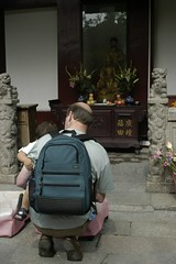 at the shrine (minicloud) Tags: china 2004 anne shrine dad backpack wuhan crouching
