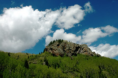 Mountain View from the Train (Thad Roan - Bridgepix) Tags: railroad blue trees sky newmexico green clouds train landscape ilovenature woods colorado rocks geology chama forests antonito cumbrestoltecscenicrailroad iloveclouds