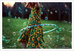 bubble dance II (FragmentaryBlue) Tags: family people playing color green childhood kids youth d50 children fun toys outdoors spring nikon interestingness1 bubbles nikond50 nostalgia hulahoop spring06 naturallightkids tc40bubbles