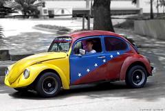 carcacha (ruurmo) Tags: auto blue red people 15fav beautiful car yellow azul 510fav photoshop wow volkswagen nice rojo gente venezuela great 7 2006 ruurmo caracas casio amarillo estrellas tricolor carro siete babel 1on1 excelente carcacha tricolorvenezolano