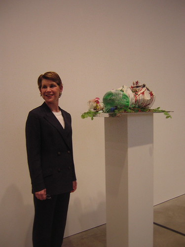 Shaw poses with Genzken sculpture