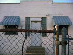 6343 (nick findley) Tags: house fence rust stlouis numbers saintlouis dogtown cinderblock