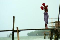 duwa (Farl) Tags: wood travel sea house water colors girl strand airplane fun toy island kid play muslim philippines poor tshirt impoverished manmade reality sulu reef propeller economy pathway stilts mindanao tawitawi samal bluelist simunul tubigindangan