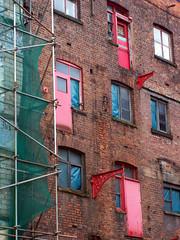 Red Doors (Neil101) Tags: door uk windows red england urban colour brick mill window wall macintosh manchester fire scaffolding doors escape kodak neil warehouse renovation mills wilkinson z740 warehose neilwilkinson neil101 bbcmanchesterblog
