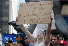 Give 'Em A RAISE!! (buff_wannabe) Tags: nyc rally poor protest police nypd demonstration cop