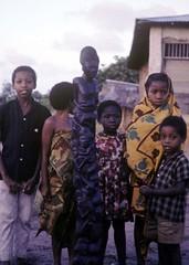 Kids with Makonde carving (halifaxlight (back in March)) Tags: children tanzania group carving makonde kitenge kunduchi neardaressalaam