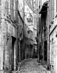 Prigueux: a street in the old part of town 2(b&w) (mistca) Tags: prigueux france dordogne perigord history medievil art bw black white street urban city town cobble stone narrow nikond70 photoshop artistic architecture 15fav 2870mmf3545d 510fav 1025fav 2550fav 100v10f