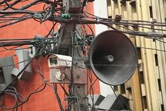 thailand surveillance camera megaphone spycam powerlines red outdoor