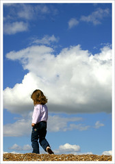 walking on clouds (MariaJC) Tags: ocean uk england people beach girl topv111 clouds 1025fav children lafotodelasemana heaven walk simple interestingness146 i500 flickrsbest lfsnubes abigfave aplusphoto