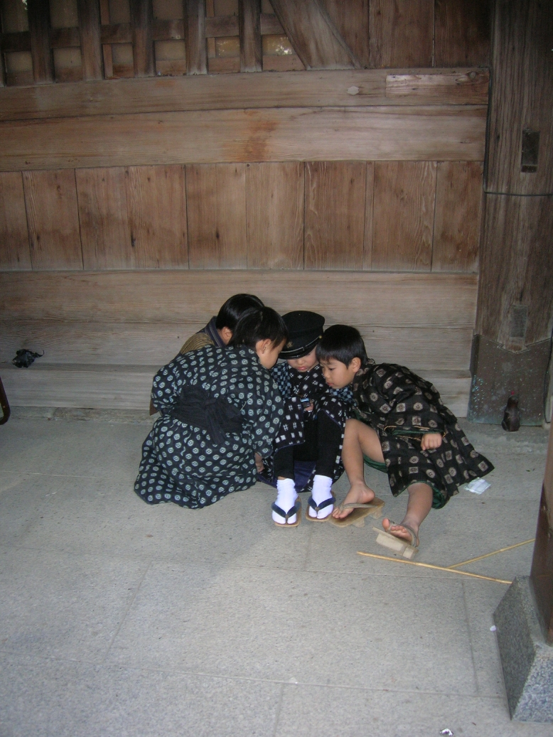 Japanese kids playing gameboy