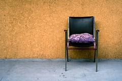 chair (neilbruder) Tags: canada wall vancouver outside chair backalley purple mountpleasant cushion tassels