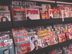 men's magazines also have women on the front c...