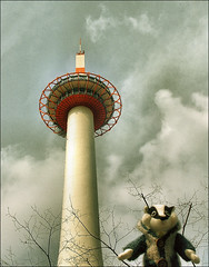 . And now for something completely different . (3amfromkyoto) Tags: trees sky cute tower 2004 wool japan clouds wow toy japanese for march friend kyoto funny different buttons bare humor jim visit scene humour cutie plush badger badgers   now something cardigan completely  woollen cardy kyototower  jimu  3amfromkyoto flickr:user=3amfromkyoto