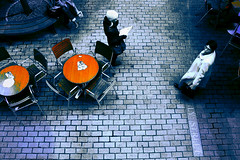 Lost in transition (Wen Nag (aliasgrace)) Tags: people orange woman london topf25 female top20favorites table lost colours chairs explorer bricks creative streetshots explore 50100fav transition caf top20halloffame sr81 aliasgrace 72points abigfave