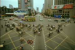 crisscross (birdcage) Tags: china lg bicycles pentaxk1000 advertisements e6 yellowbus