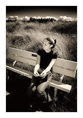 Lucy on Bench (KF ) Tags: eos300d northberwick scotland summer sepia blackwhite photoshop interestingness girlfriend girl love beautiful thoughful bench beach sea grass light shadows lookatme