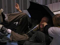 Violence (Kurrs) Tags: rg rehearsal internationalvillage violence punch angus christopher umbrella dreadlocks blackspots fake playing