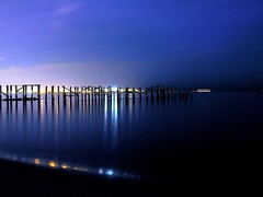 piering at brooklyn (nj dodge) Tags: ocean nyc longexposure topf25 water beautiful brooklyn night bravo niceshot 500v20f quality listeningto viewlarge pilings statenisland entitled oldpier h13 1000v40f gratefuldeaddickspicksvolume6