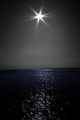 Soleil noir... (Christine Lebrasseur) Tags: ocean blue sky sun france art water canon cutout 350d marine noiretblanc atlantic onblack capferret interestingness39 quoteme fcsea allrightsreservedchristinelebrasseur landscapeseascapeskyscapeorcityscape