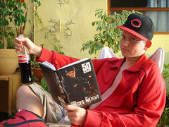 chad ([ jaded rabies ]) Tags: red portrait plants chicago man male guy hat glasses book cola cent coke read dimple 50 coca