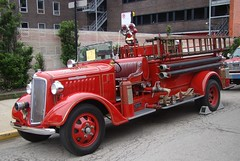Fire apparatus gather in staging area. (Chicago Rail Head) Tags: displays firetrucks openhouse oldnew vendors chicagofireacademy fireapparatus firememorabilia opencabpumper firemuseumofgreaterchicago the511club demonstationsrides 1935seagrave classicfiretrucksmuster