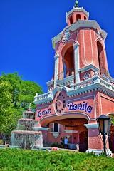 Casa Bonita (slammerking) Tags: pink sky tower clock fountain restaurant wroughtiron landmark denver entertainment chandelier banister cb casabonita stucco shrubbery spanishstyle baluster lakewoodcolorado