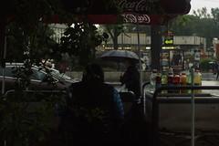 Street seller (xjoexx) Tags: street city people rain pentax 3728 k100d 1
