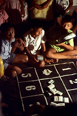 26-294 (ndpa / s. lundeen, archivist) Tags: boy people bali gambling color film boys kids 35mm children indonesia table soap child 26 nick numbers southpacific 1970s 1972 indonesian gambler balinese dewolf oceania pacificislands youngmen gamblers barsofsoap nickdewolf photographbynickdewolf reel26