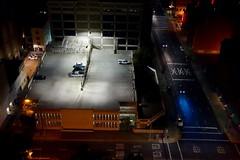 XXX [Explored] (KevinIrvineChi) Tags: california street blue cars car northerncalifornia night amber parkinglot parkinggarage parking fromabove peek sacramento lit xxx lookingdown ochre flickrexplore explored