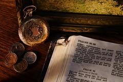All That Is Gold Does Not Glitter (Dane Vandeputte) Tags: nikon d7200 nikond7200 f11 50mm sigma1750mmf28exdcoshsm bible christianity psalms book pages text diamond ring old coins indian wheat cent penny pennies nickel mercury dime pocket watch pocketwatch painting frame gold silver wood grain light shadow warm stilllife longlight evening flickrchallengegroup thechallengegame challengegamewinner flickrchallengewinner