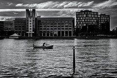 Silent Evening (Claus Tom) Tags: street city urban blackandwhite bw man game building male sports water silhouette sport architecture sailboat port buildings copenhagen denmark boats evening harbor boat construction marine sailing candid streetphotography hobby transportation sail recreation hobbies activity cph kbenhavn activities passtime islandsbrygge physicalactivity recreationalactivity