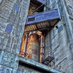 Concrete Sun (JamesAnok || ThetaState) Tags: sunset toronto ontario canada abandoned metal concrete rust industrial august silo walkway ladder canadamalting 2015