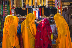 Colours of desert (Karunyaraj) Tags: yellow colours red women shopping coloursofdesert ornament pushkar pusharfair rajasthan india indianwomen yellowsaree redsaree cwc cwc561 chennaiweekendclickers nikond610 d610 fullframe fx